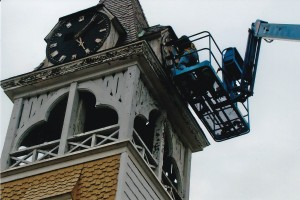 Ron pulling one of the old clock faces off